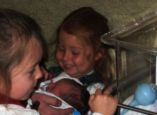 Addison holding darcy for the first time