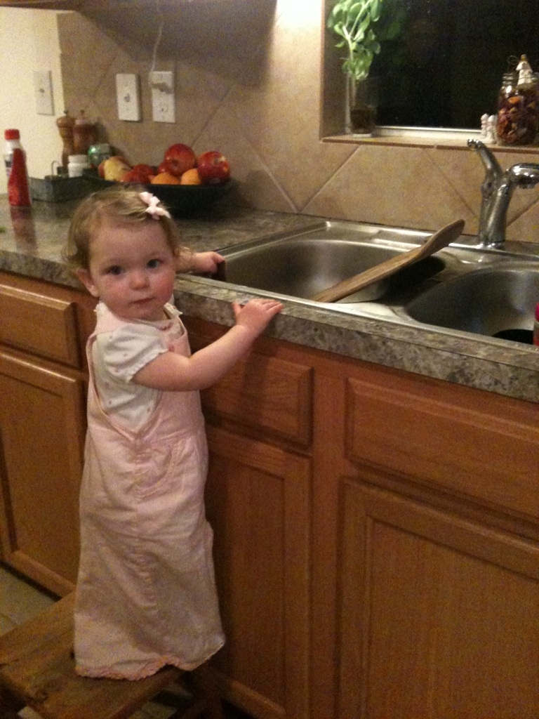 Darcy doing dishes
