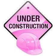 Pink under construction sign